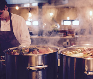Image of a chef cooking food.